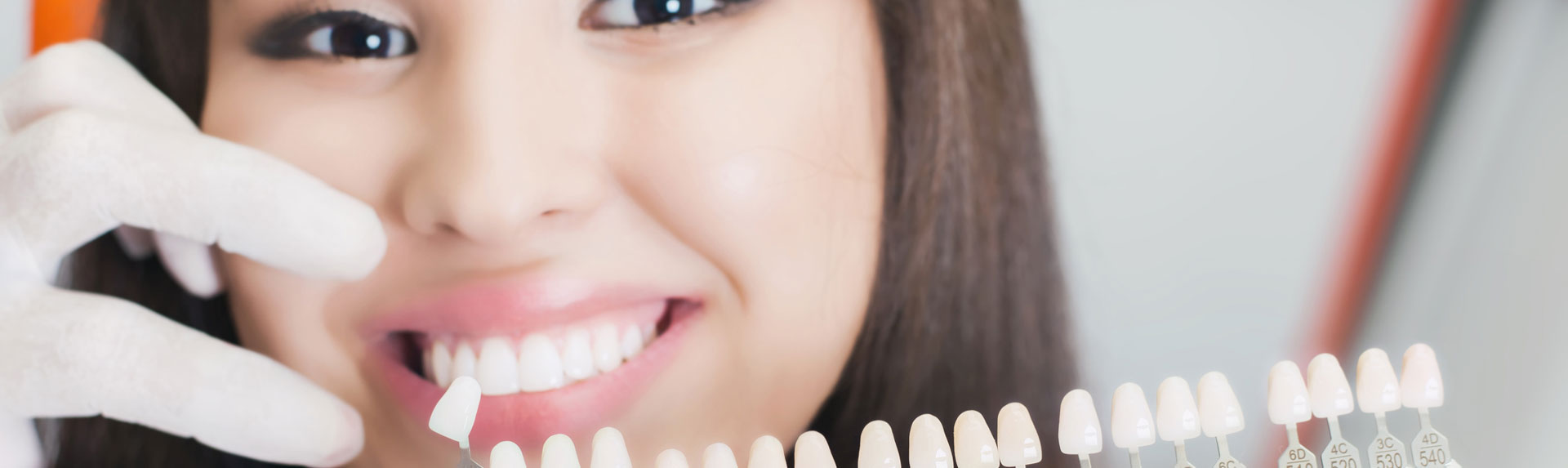 Smiling woman checking her teeth color