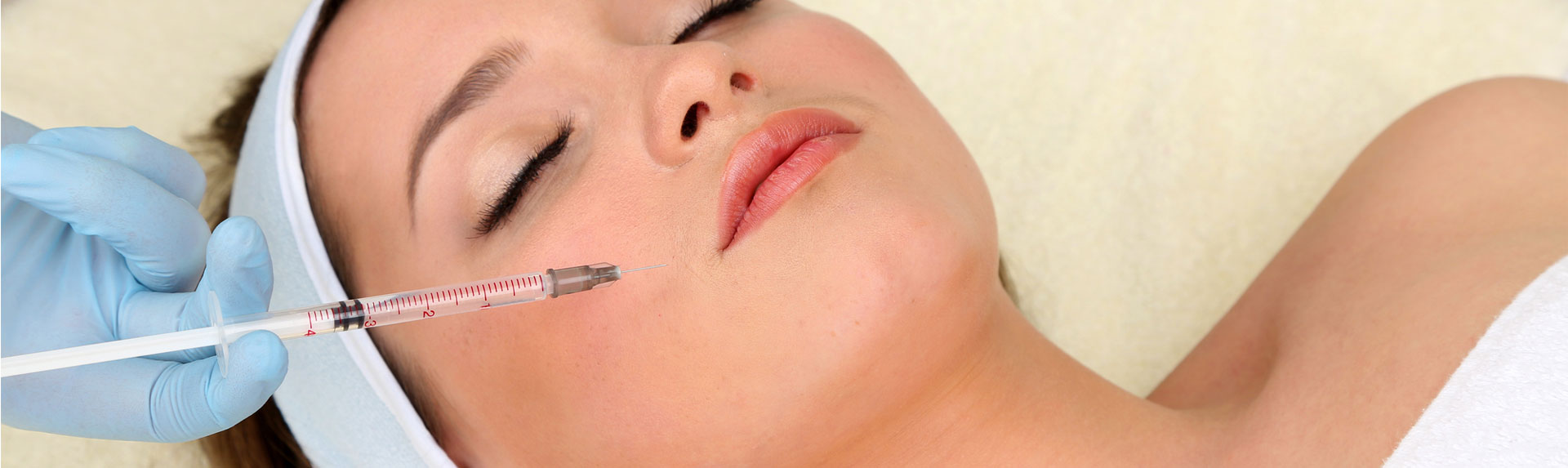 Young woman receiving botox injection