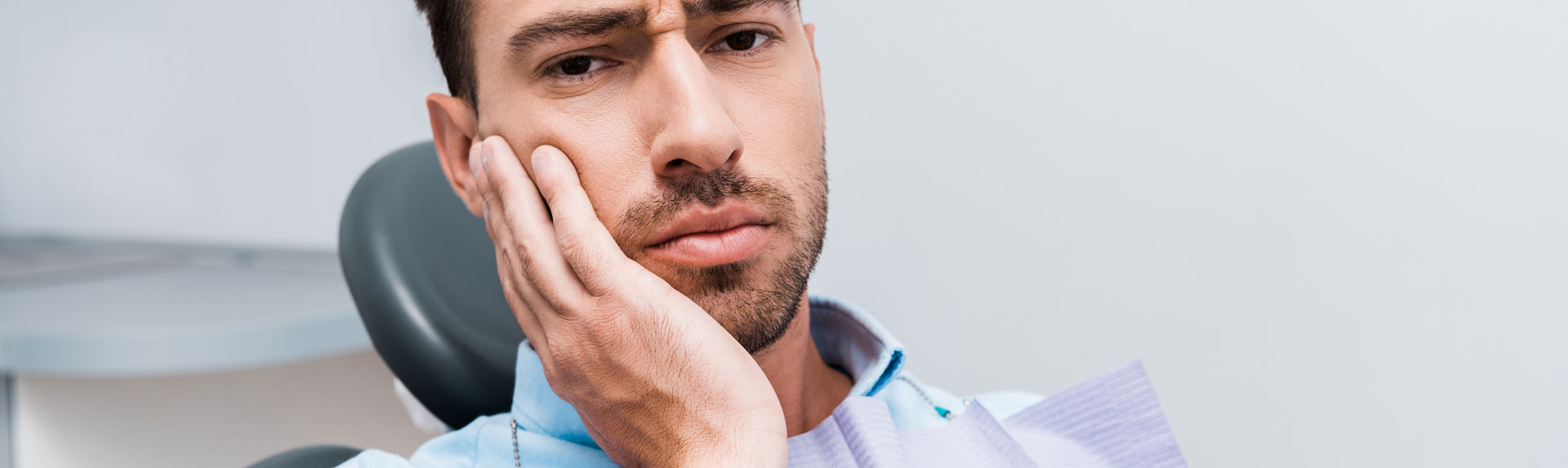Man having toothache in dental clinic