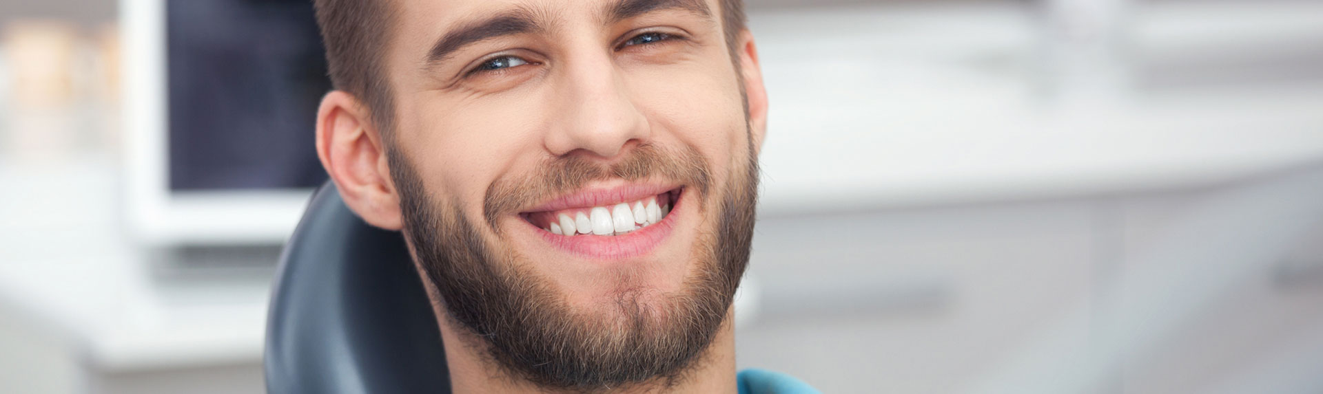 Smiling man sitting in the dental chair
